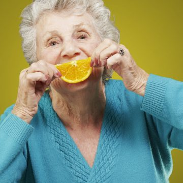 aged-lady-with-an-orange